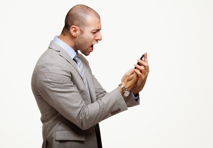 Angry man with smart phone 2.jpg